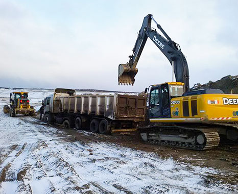 True teamwork. A 2000 Series Excavator and a motor grader working together to get the job done on a cold day.