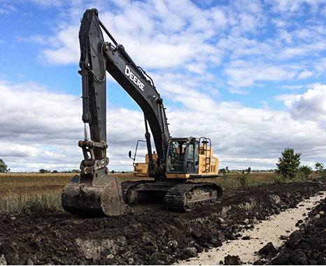 """450D shaping ditches along Toll Road 88 in Northern Illinois."""