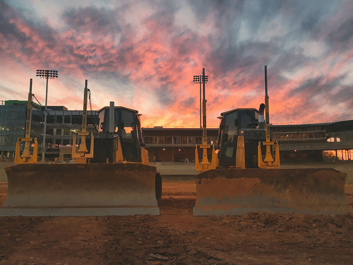 """After a long day of moving dirt in Columbia, South Carolina for my company Precision Turf, LLC, I captured this beautiful sunset as well as these two wonderful John Deere machines!"""