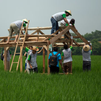 john-deere-employees-build-a-structure-in-a-rice-field