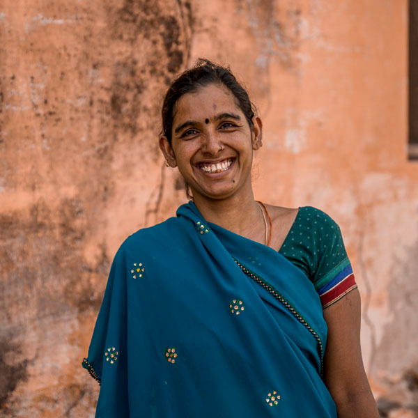 "Seema Suthar is a JIVA field worker in the village of Sakrawas. ""I belong to the Sakrawas village and have been working for JIVA since the beginning. It makes me proud to know I'm helping increase the income of farmers in my village."""