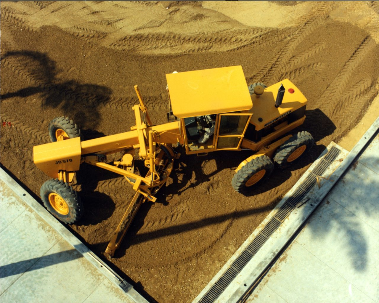 Blast from the Past; The JD570 Motor Grader in action.