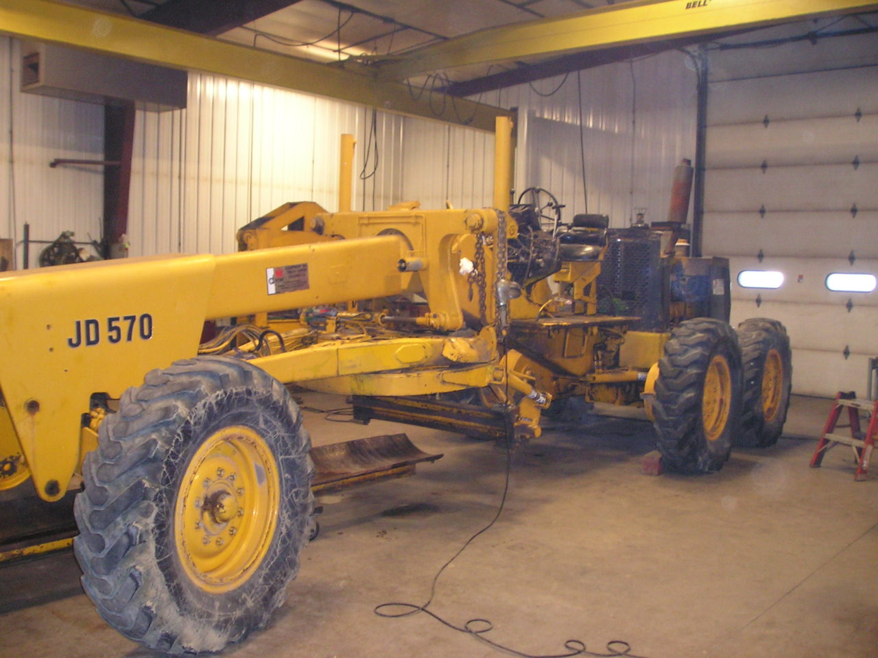 Don and Jerry spent a total of 2,200 hours from December 2014 to December  2015 restoring the JD570 Motor Grader.