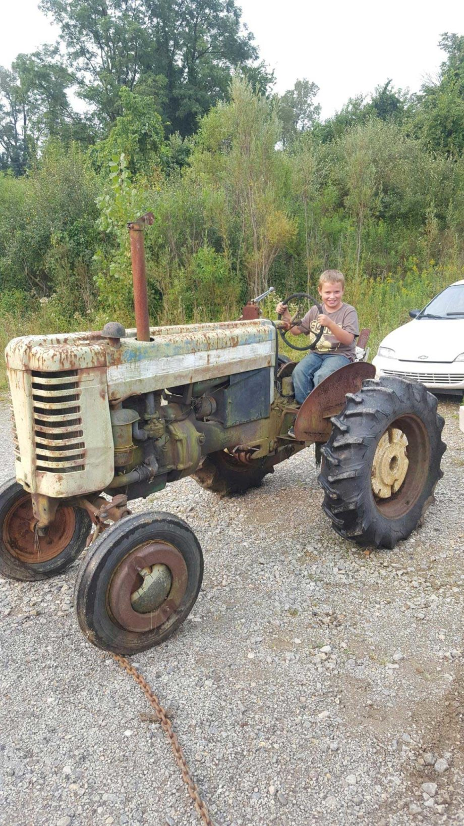 A Little Boy, Great Grandpa's Tractor, and an ...